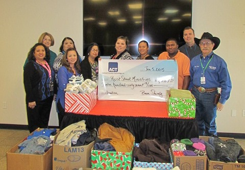 Brian Shively, Director of Operations (back row, far right), and other members of the ACT San Angelo office present a donation of cash and goods to representatives of Rust Street Ministries.