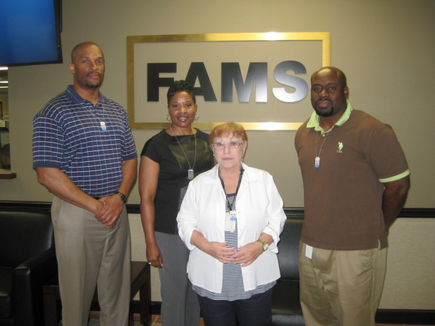 FAMS employees in Georgia show off their donor dog tags. (From left to right): Sharn Fuller (veteran), Cheryl Parks (veteran), Ann  Katz (mother of veterans) and Benjamin Smith (veteran).