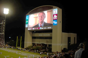 """An ad shown at a recent Mississippi State University football game showcased the """"One, Mississippi"""" campaign and Insurance Commissioner Mike Chaney (Photo by Mississippi Insurance Department)."""
