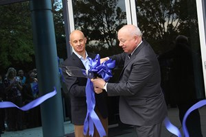 Norfolk Mayor Paul D. Fraim, at right, celebrates expansion of Portfolio Recovery Associates headquarters with CEO Steve Fredrickson.