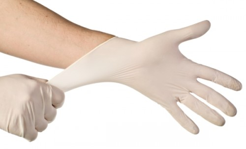 doctor-getting-ready-for-exam-latex-gloves