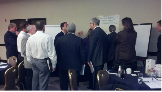 A group of Summit participants discuss a specific issue in a working breakout session.