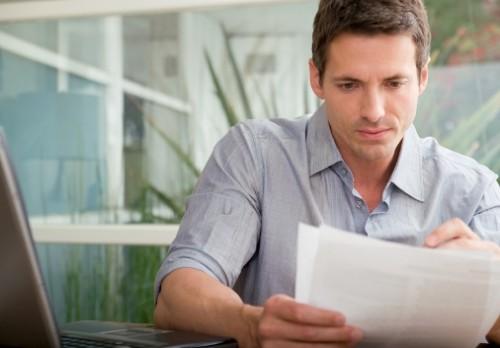 man-reading-letter